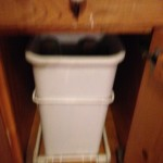 Recycle - To the right of the trash in the next cabinet